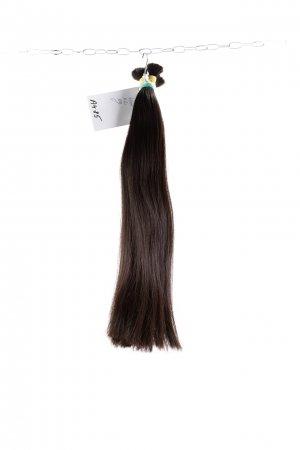 Přírodní vlasy plné v koncích.