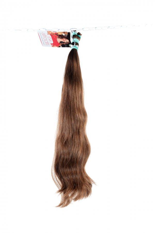 Vlnité vlasy v hnědém odstínu