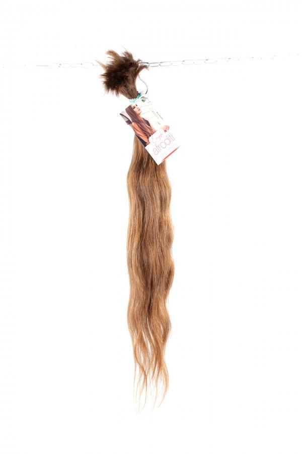 Světlé lehce vlnité vlasy