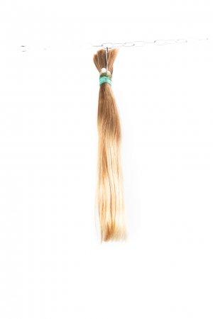 Rovné dětské nebarvené vlasy na prodlužování.