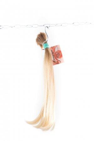 Rovné jemné dětské vlasy na prodloužení vlasů.