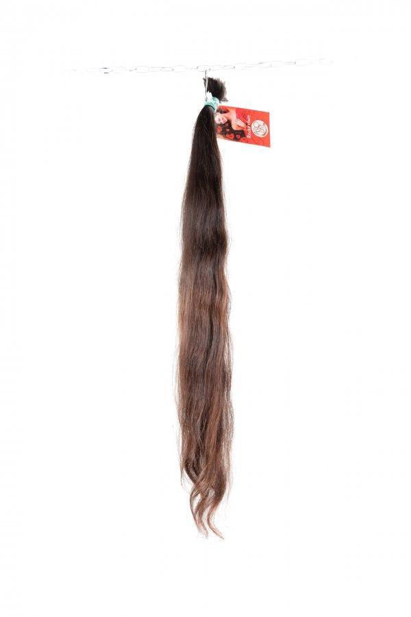 Vlnité vlasy na prodloužení přírodní odstín.