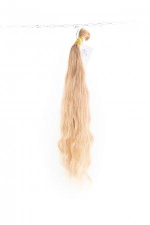 Vlnité blond slovanské vlasy k prodloužení.