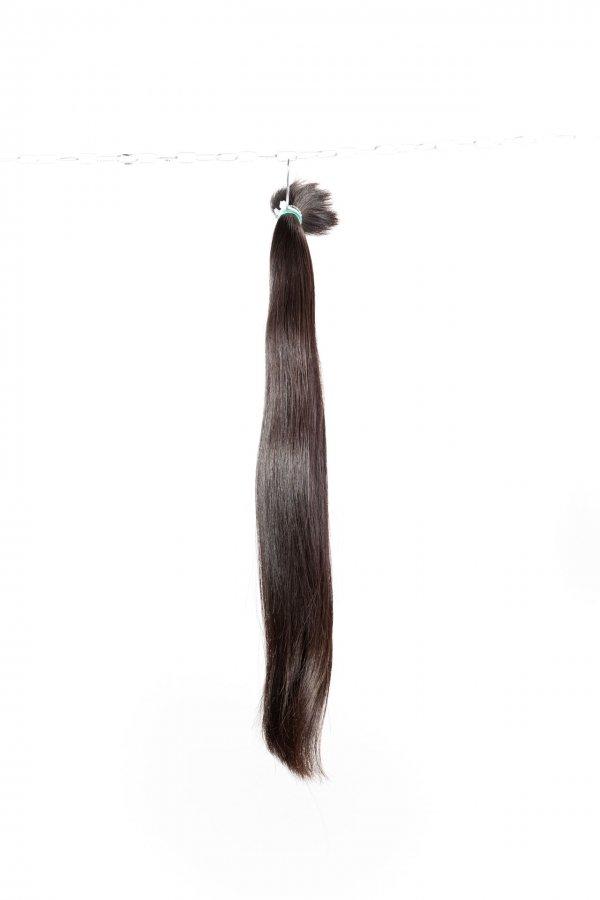 Tmavé rovné vlasy pro prodloužení vlasů.