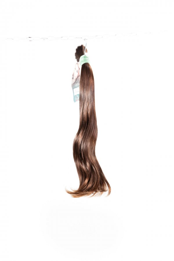 Přírodní hnědé vlnité vlasy k prodlužování vlasů.
