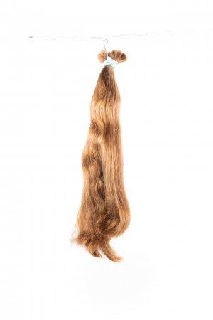 Lehká vlna světlých vlasů k prodlužování.