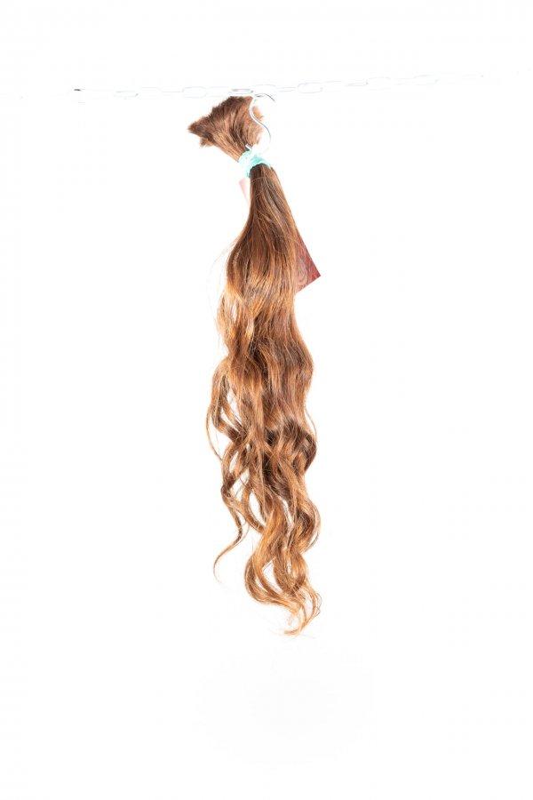 Vlnité světle hnědé vlasy k prodlužování.
