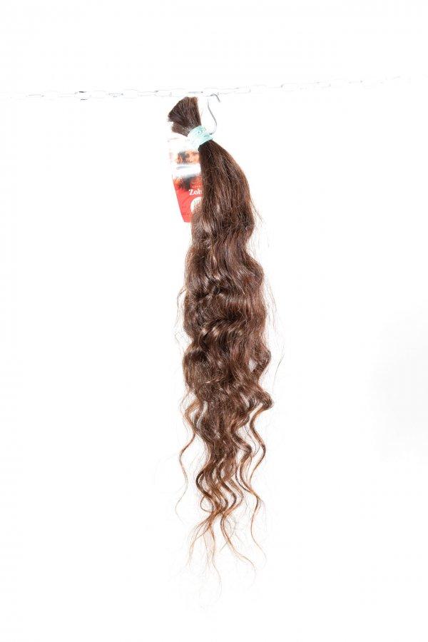 Přírodní vlnité vlasy na prodlužování.