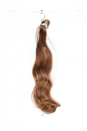 Světlé objemné vlasy evropského původu