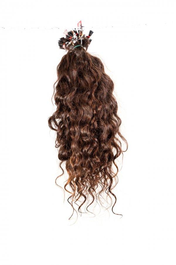 Kudrnaté hnědé vlasy k prodloužení