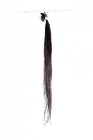 Tmavé přírodní vlasy k prodloužení.