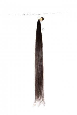 Vlasy na prodloužení v hnědé barvě.