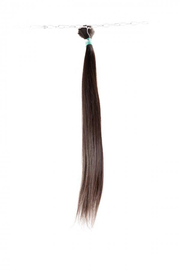 Tmavé panenské vlasy k prodloužení.