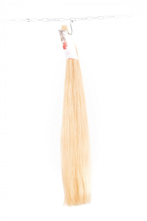 Dlouhé světlé vlasy na prodlužování.
