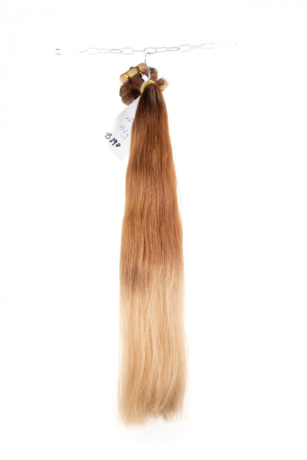 Vlasy na páskách na prodlužování vlasů.