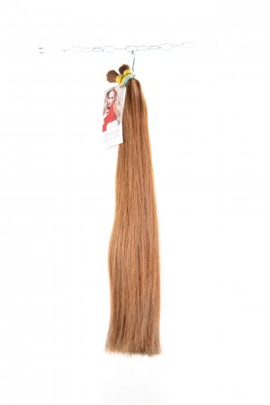 Dlouhé barvené vlasy na prodlužování vlasů.