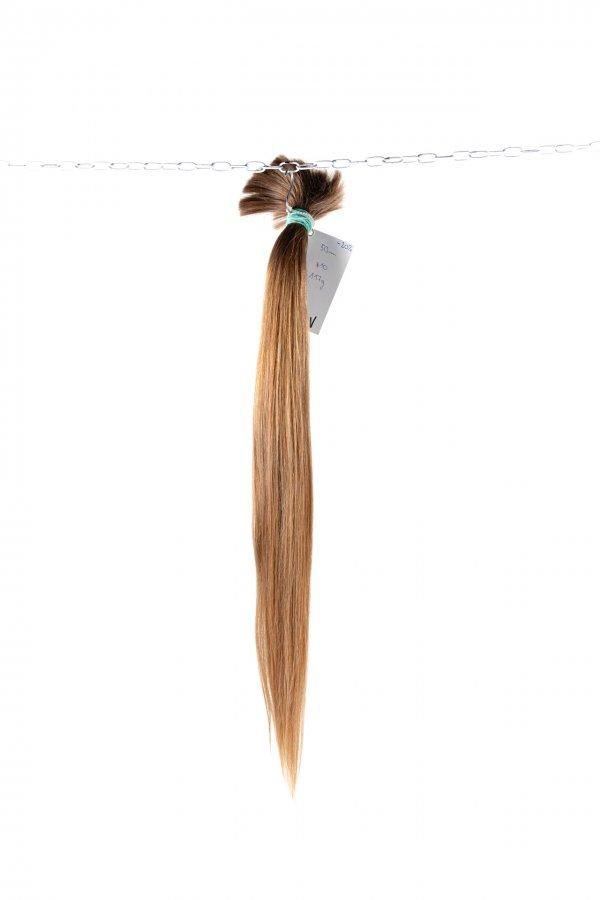 Světle hnědé vlasy jemné struktury