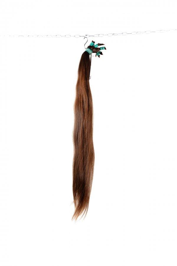 Středně hnědé vlasy z výkupu