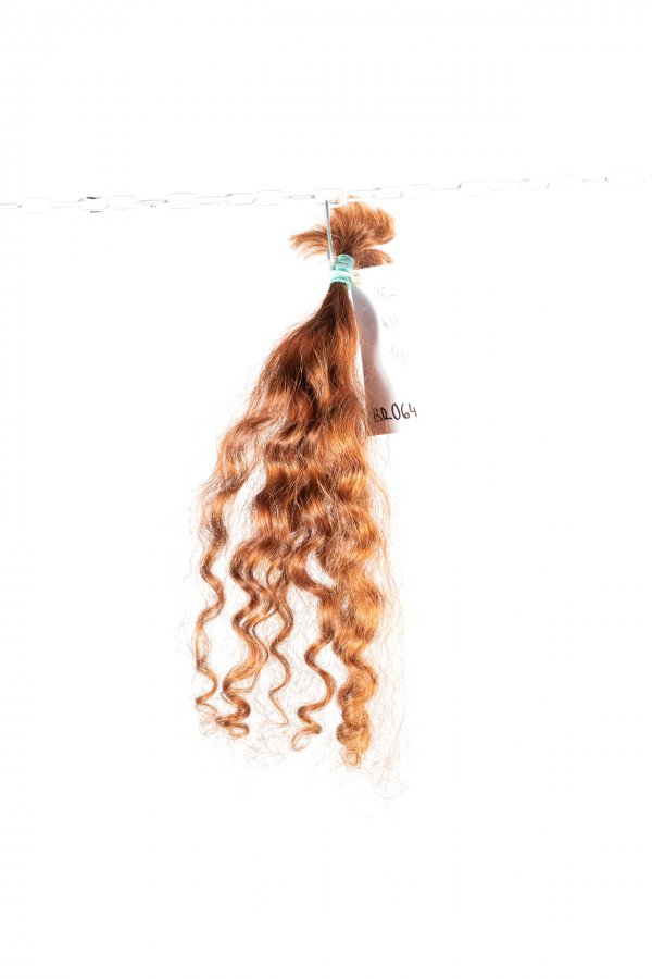 Kudrnaté vlasy k prodloužení vlasů.