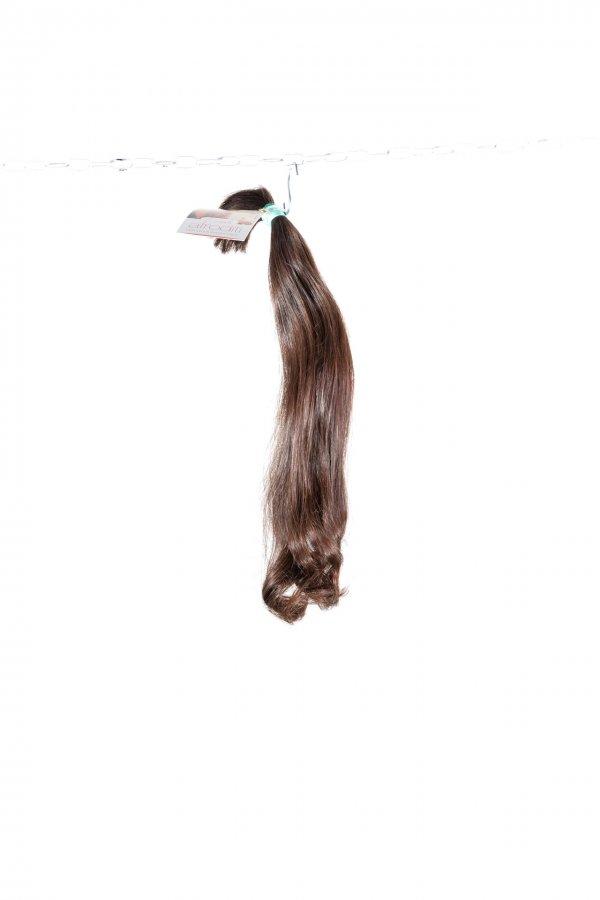 Rovné hnědé vlasy k prodlužování vlasů.