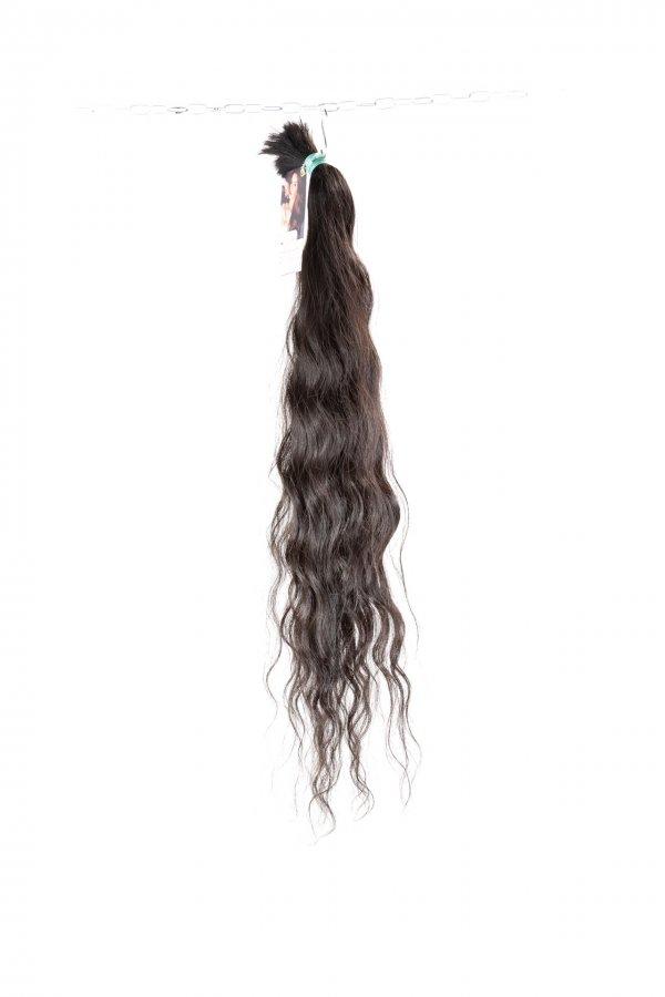 Vlnité vlasy k prodloužení.