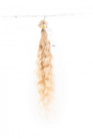 Pevná vlna světlých vlasů na prodlužování