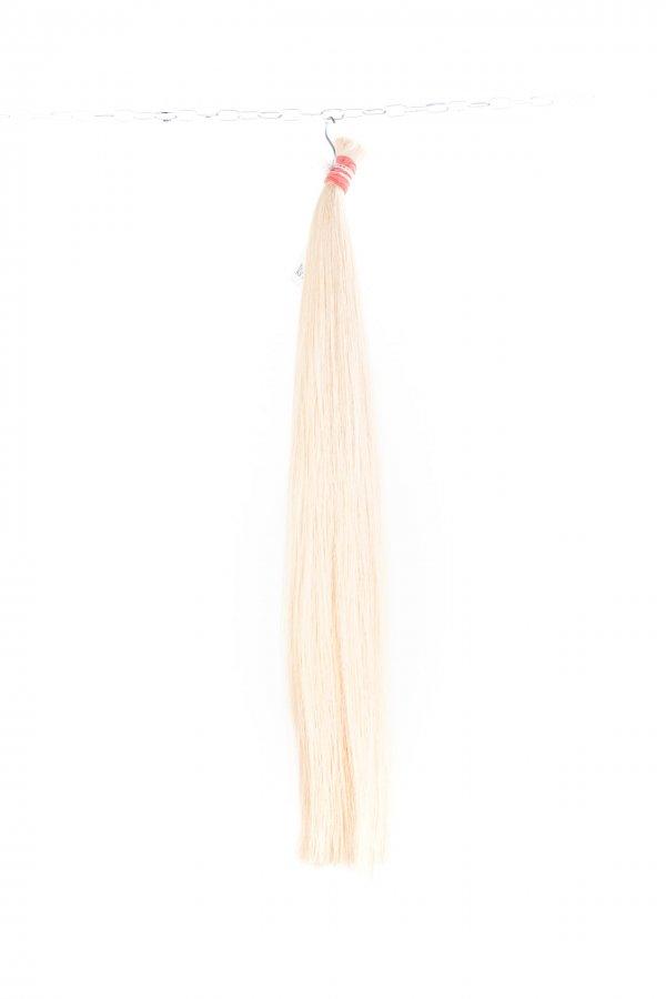 Světlé kvalitní vlasy k prodloužení.
