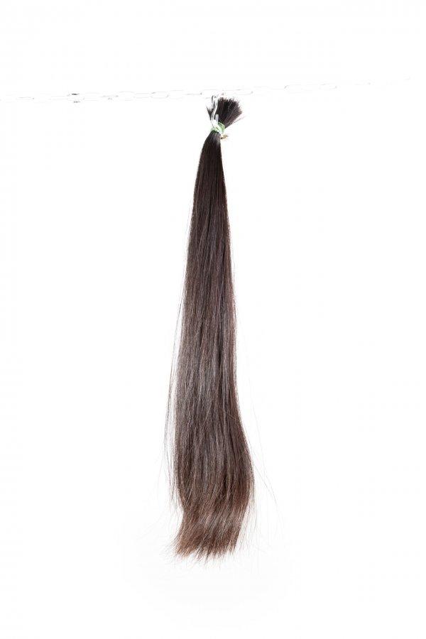 Rovné hnědé vlasy na prodlužování.