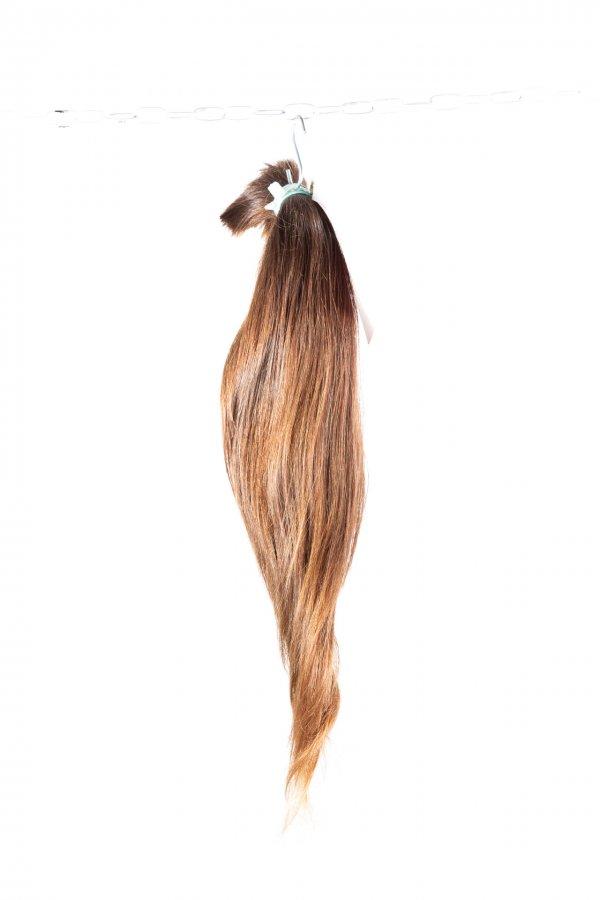 Vlnité vlasy k prodloužení vlasů.