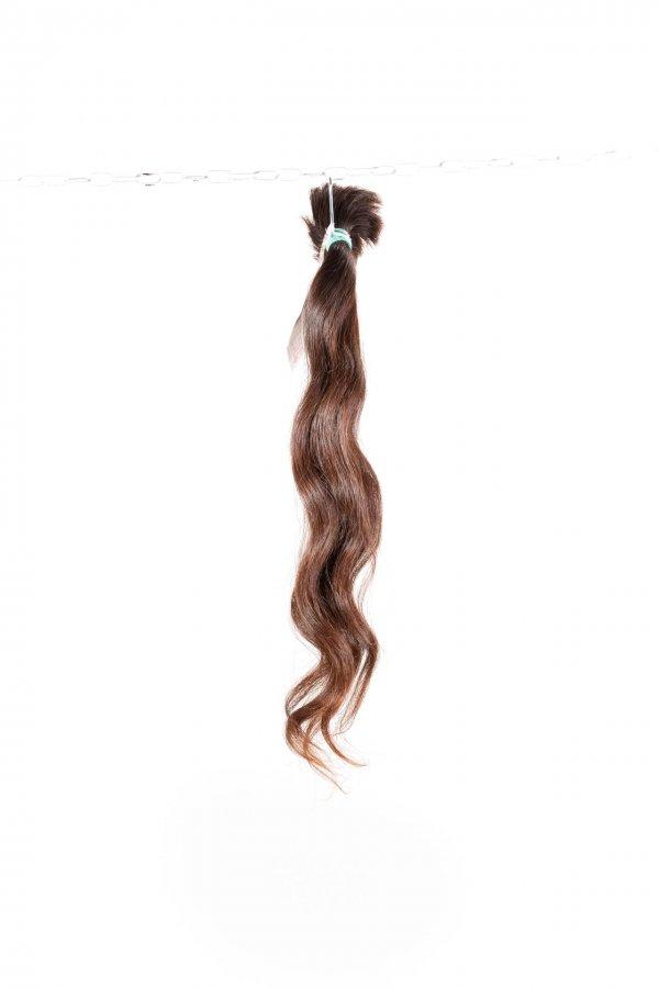 Vlnité vlasy na prodloužení vlasů.