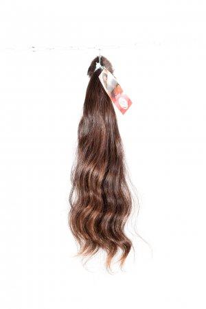 Vlnité vlasy na prodlužování vlasů.