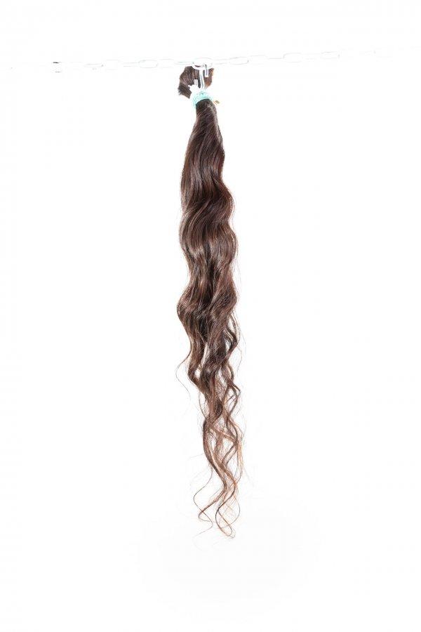 Dlouhé vlnité vlasy k prodlužování.