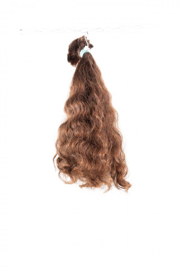 Kudrnaté vlasy k prodlužování vlasů.