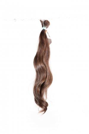 Vlnité přírodní vlasy na prodlužování vlasů.